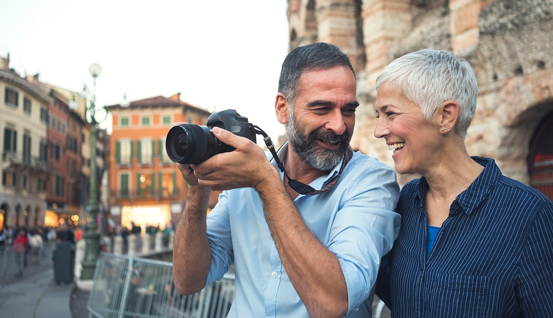 Senior couple taking travel photos