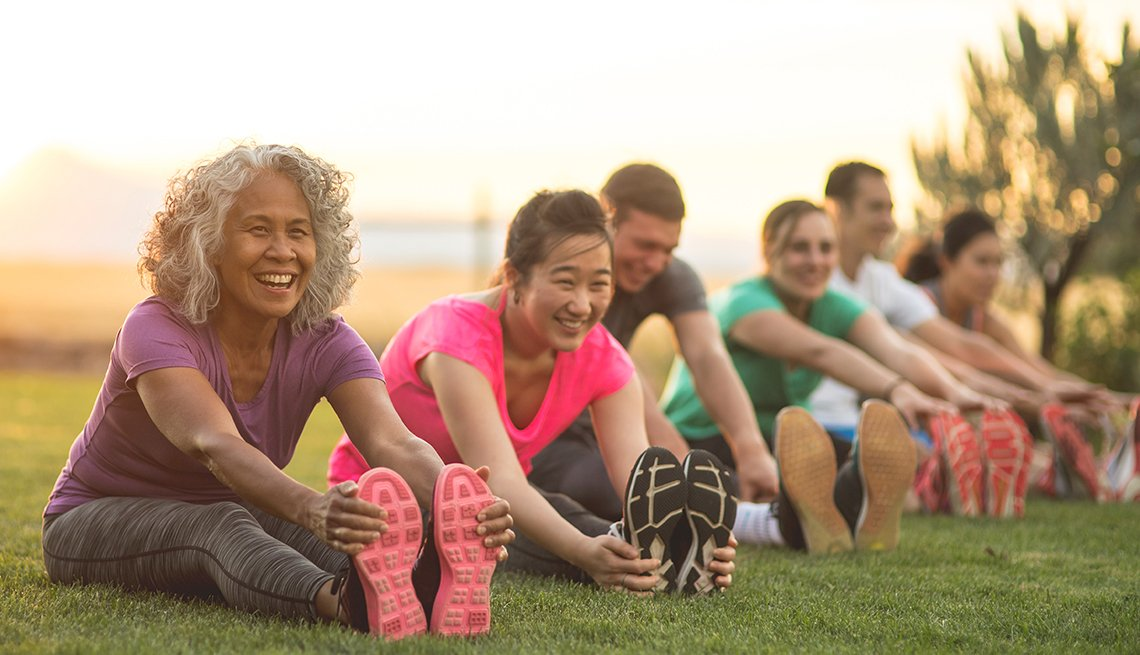 Runners stretching on grass