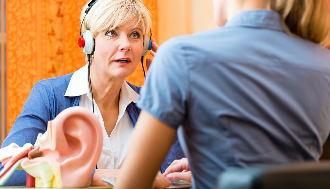 Mature woman having hearing test