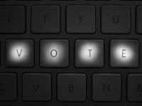 Teclado con las letras: v,o,t,e iluminadas – Cómo inscribirse para votar.