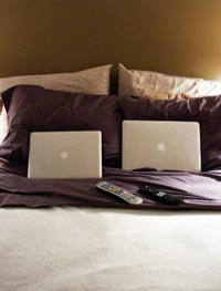 laptops on bed