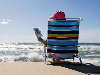 using an e reader at the beach