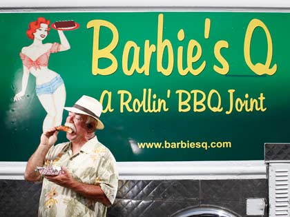 man eating barbeque