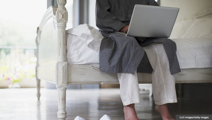 New technology allows people to access medical care at home - a man speaks with his doctor through his computer
