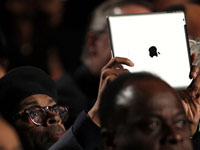 Director Spike Lee holds an iPad.