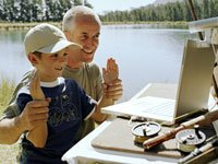 Older father and son on web camera on fishing trip for Internet on the Go