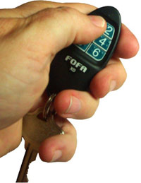 Hand using key FOB for Find One Find All device