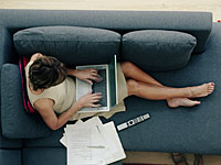 How to install a wireless network in your house - a woman uses her laptop computer on the sofa