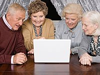 What's worth watching online - senior adults looking at laptop