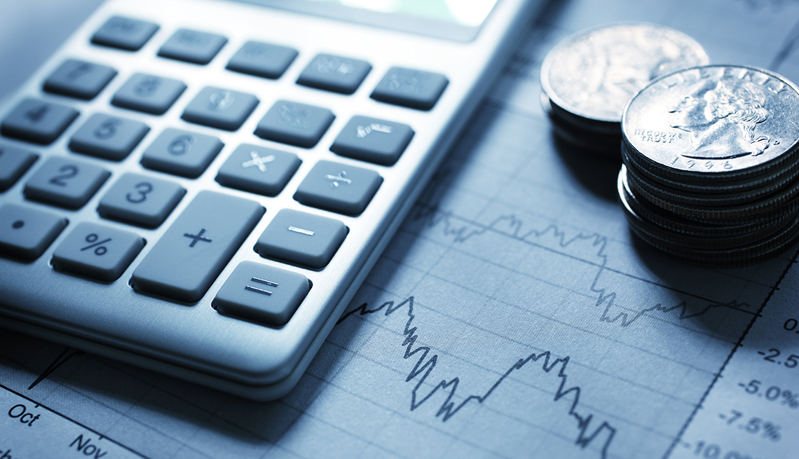 Calculator with stack of coins, AARP Research, Data & Tools