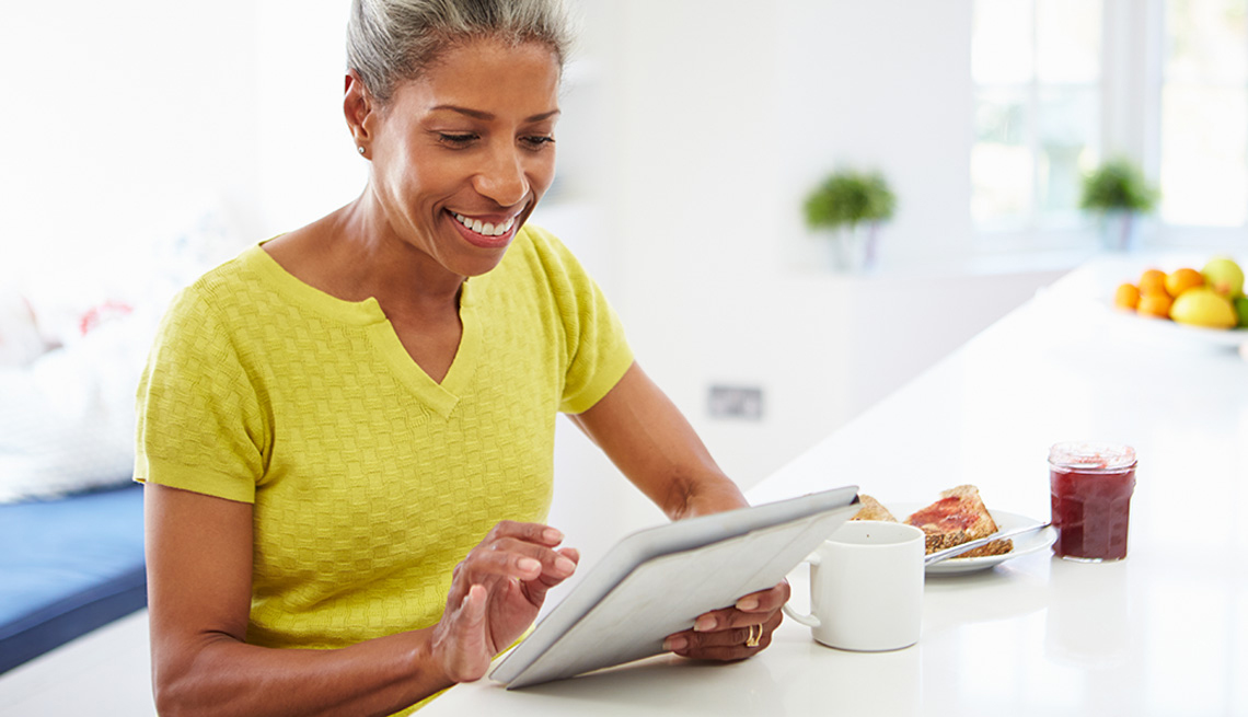 Technology, African American woman on Ipad