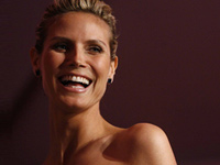 Searching a celebrity such as Heidi Klum may lead you to scammer websites that could steal your identity.