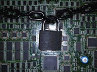 Lock chained around computer chips, online credit card application safety