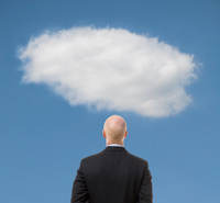 Businessman examines cloud for digital storage safety.