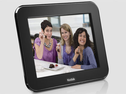goofy women pose inside a Kodak digital picture frame