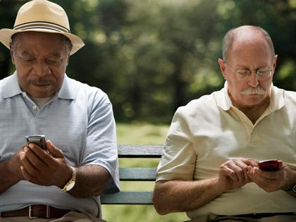 two men texting on their phones