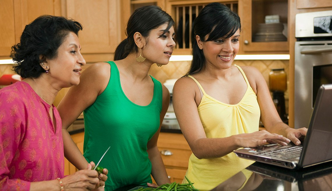 Hispanic Family In The Kitchen And Looking At A Laptop, How To Create A Group Facebook Page