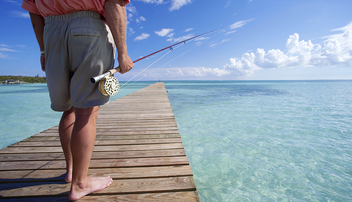 Fisherman on Ocean Dock, Abaco, Bahamas, Sunny Places to Go This Winter