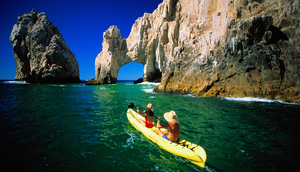 Kayakers Ocean Rocks, Cabo San Lucas, Mexico, Sunny Places to Go This Winter