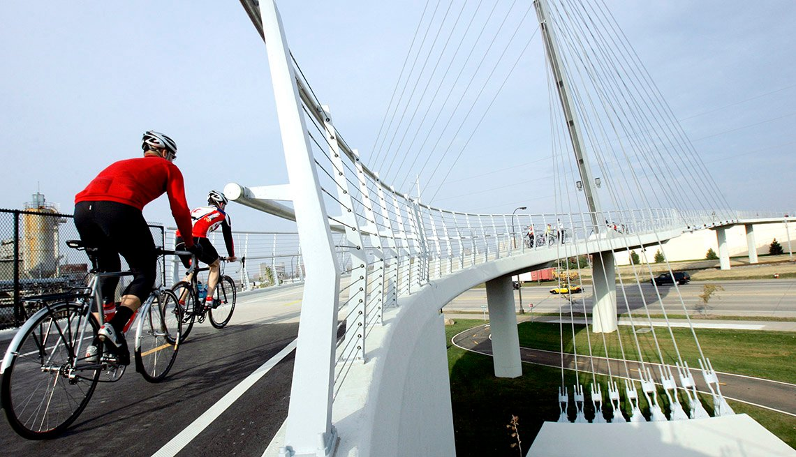 Bikers Ride Across Cable Bike Bridge, Top USA Travel Destinations