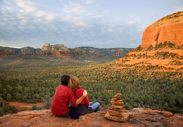 Man and Woman Sitting on Edge of Rock, Sedona, Arizona