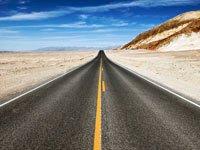 Empty highway through desert, Death Valley National Park, California