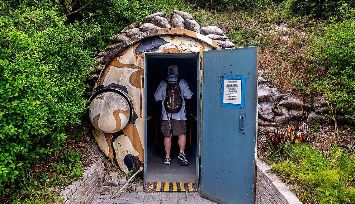 A tourist enters the Kennedy Bunker at the Palm Beach Maritime Museum on Peanut Island.