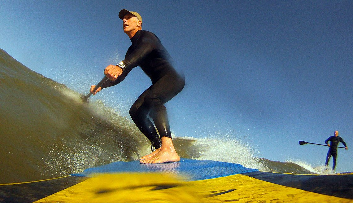 Mature Men Paddleboarding near Nags Head, North Carolina, Best Destinations for Water Lovers
