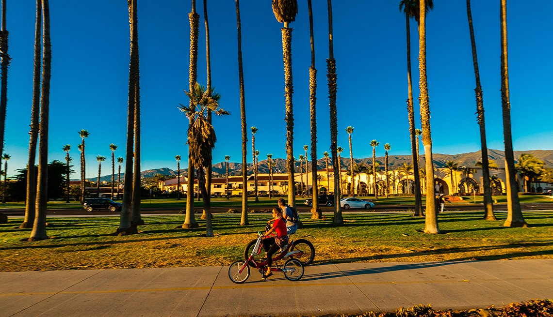Couple bicycling along a path between Cabrillo Boulevard and East Beach, Santa Barbara, California