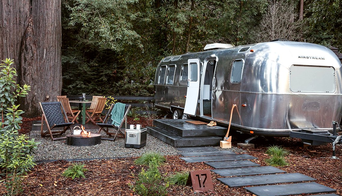 airstream trailer in woods