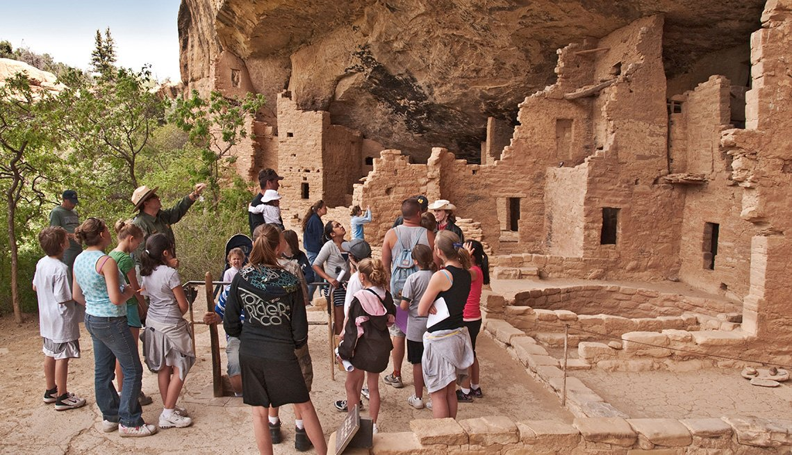 tour guide showing visitors artifacts at Mesa Verde National Park