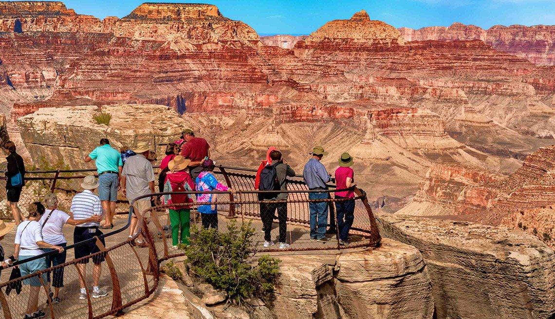 Tourists take in the incomparable vista of the Grand Canyon in Arizona from a south rim viewpoint