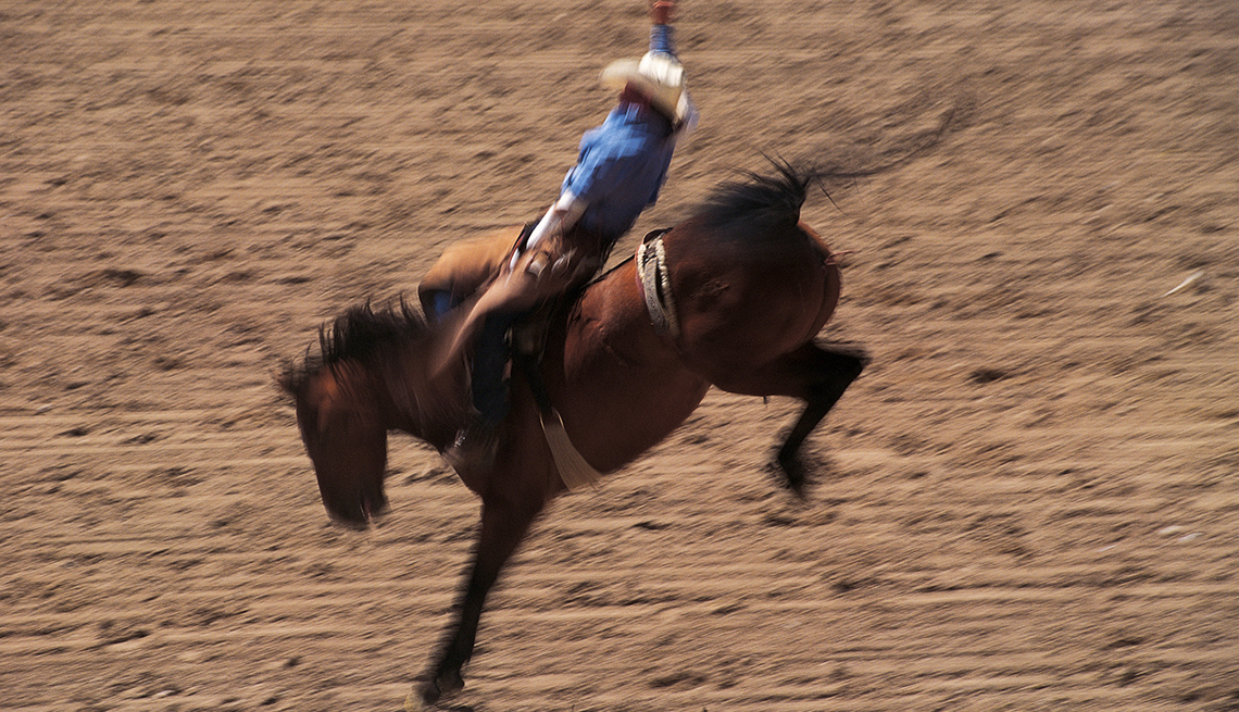 item 6 of Gallery image - man riding a horse during rodeo in Cheyenne, WY