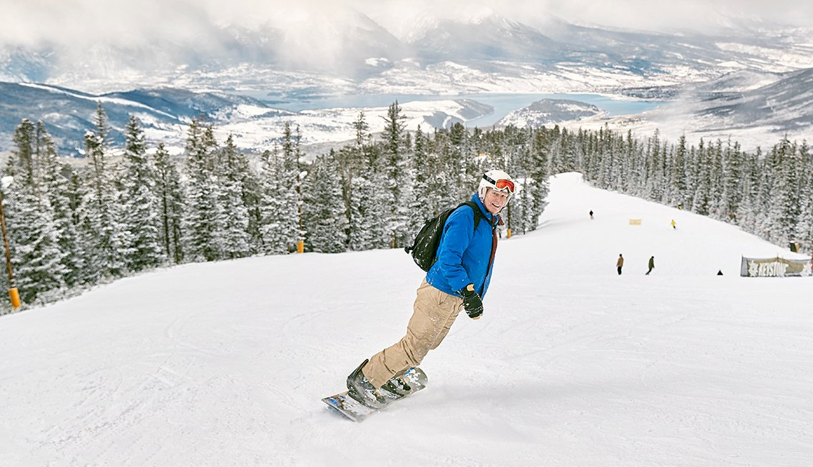 T.R. Reid snowboarding on a Colorado mountaintop