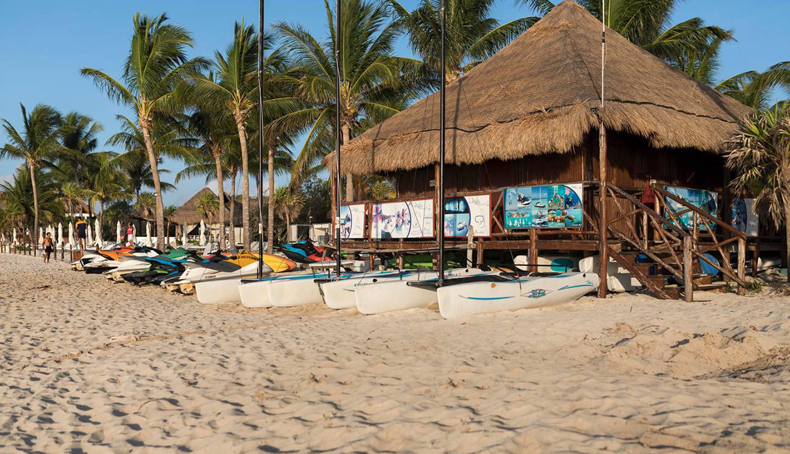 Surf shack or sports pavillion on the beach at Playa Del Carmen hiring canoes and jet skis and selling excursions