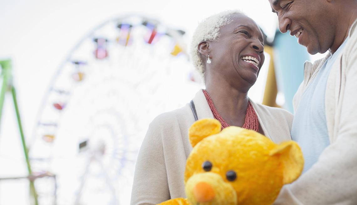 couple smiling at amusement park