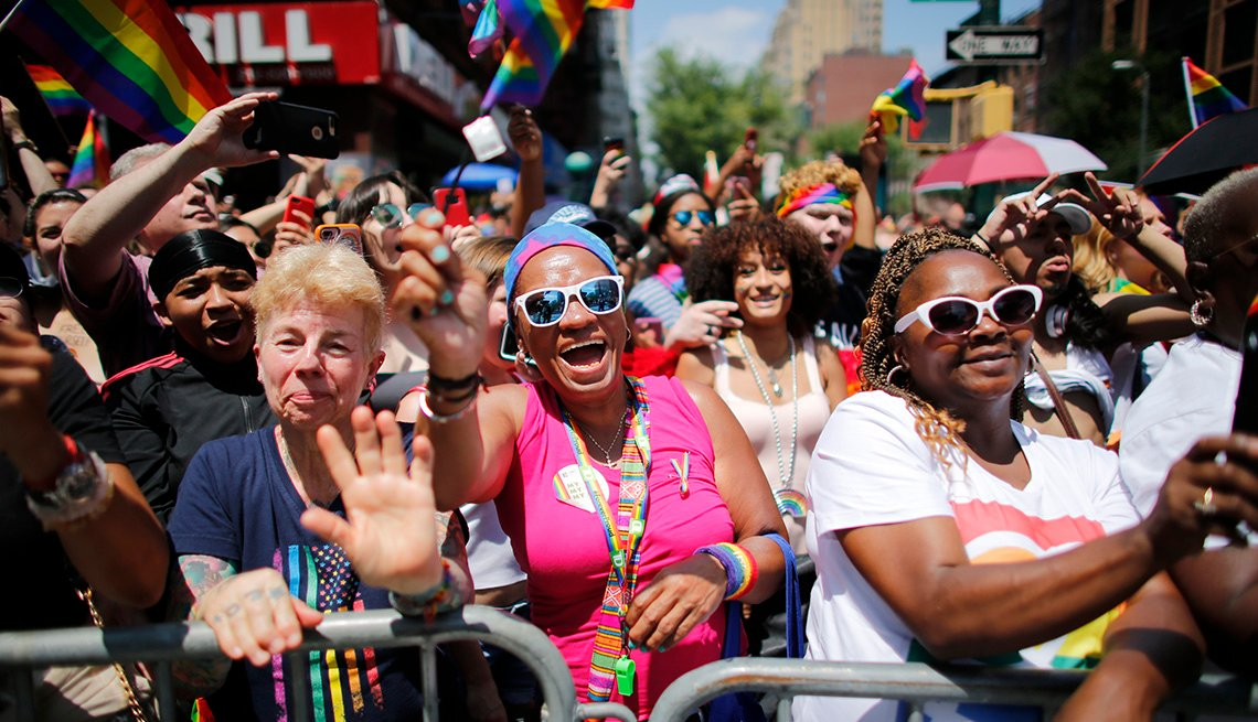 revellers watch the New York Pride Parade