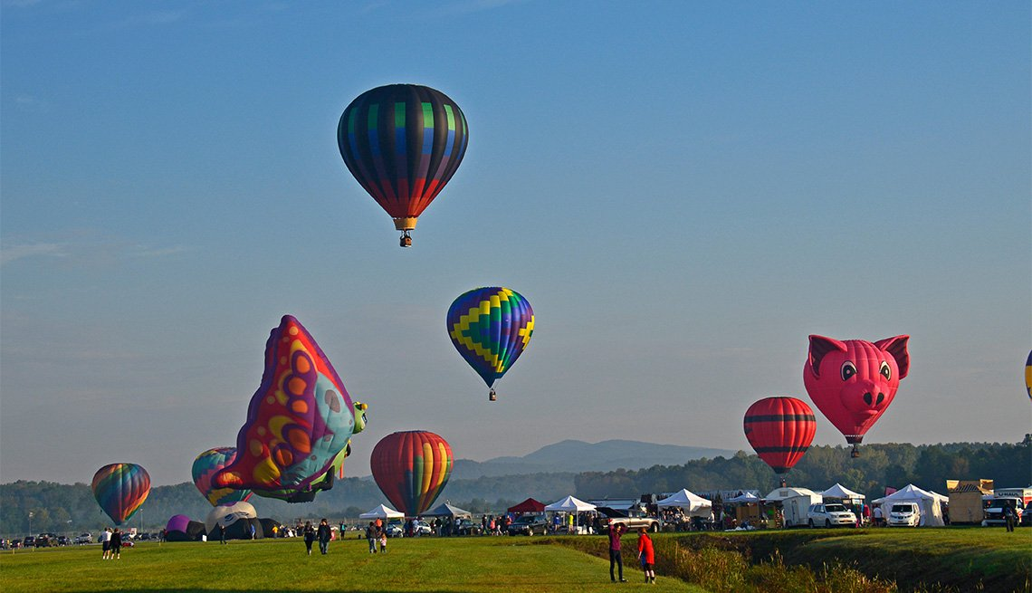 colorful balloons in the sky at the Adirondack Balloon Festival