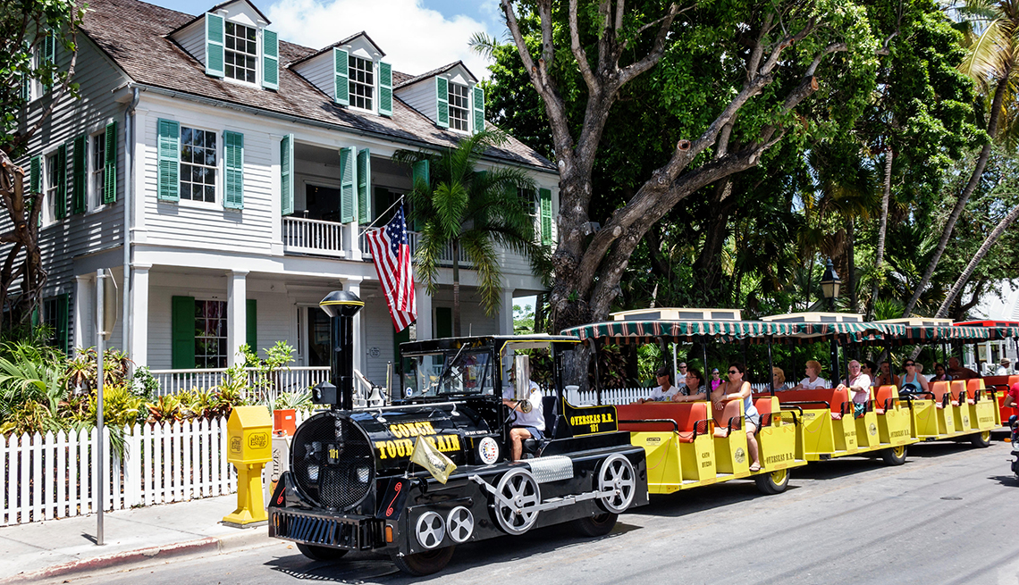Old Town Audubon House and Tropical Gardens with a black train out front in Key West Florida