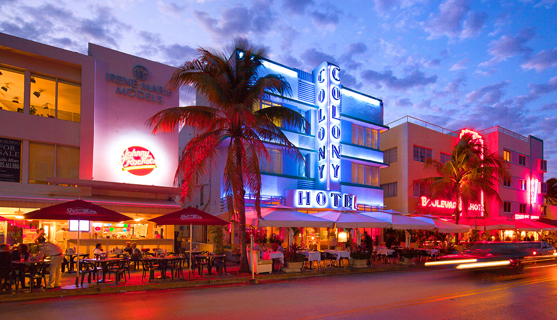 Art Deco historic buildings in Miami Florida are lit in various colors