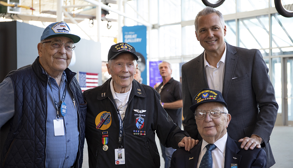 The Museum of Flight World War II Volunteers (l-r) Paul Weaver, Dick Nelms, Jim Marich and KING TV news anchor Mark Wright.