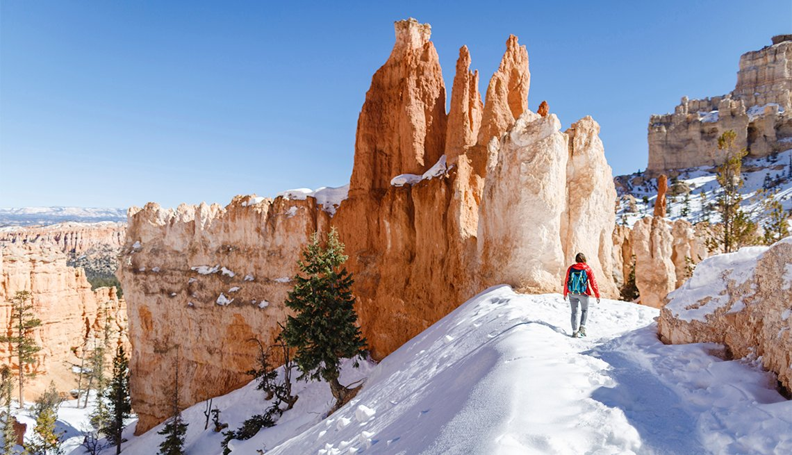 female hiker on a trail in Bryce Canyon National Park during winter