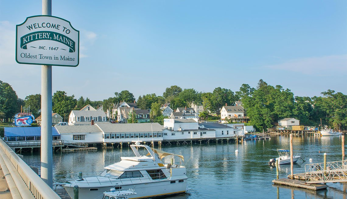 Kittery Maine welcome sign and marina with boats on bridge old town settled in 1647 oldest town in Maine