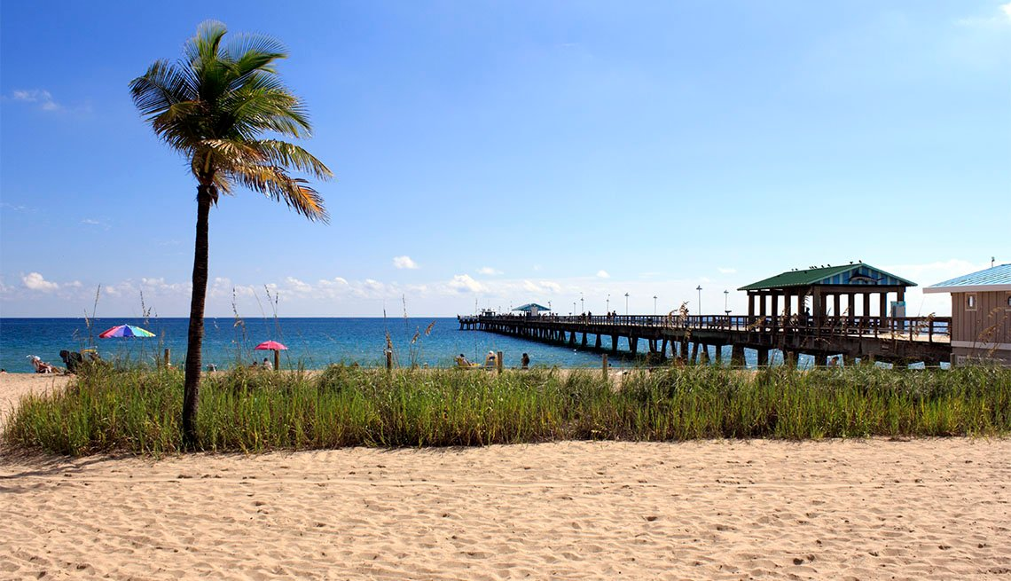 Sunbathing vacationers along the shores of Lauderdale-by-the-Sea, Florida on a beautiful day