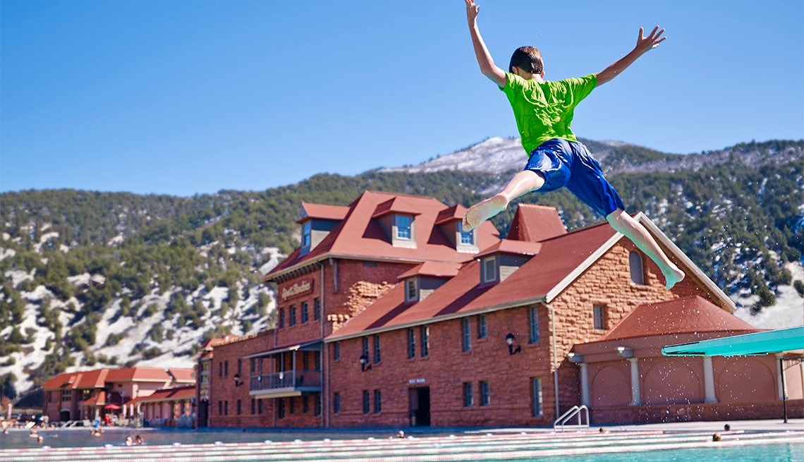 boy jumping into the pool at Glenwood Hot Springs