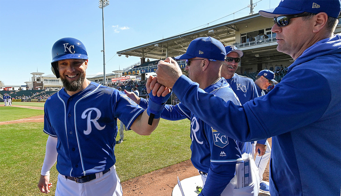 The Kansas City Royals' Alex Gordon is congratulated after scoring during spring training