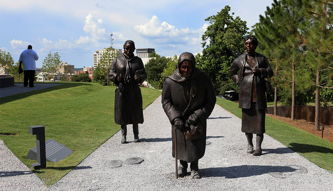 Dana King's 'Guided By Justice' statue, dedicated to black women who sustained the Montgomery Bus Boycott and collectively walked thousands of miles, stands inside The National Memorial For Peace And Justice in Montgomery, Alabama