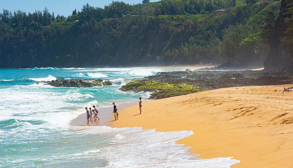 People enjoying the Secret Beach on the Hawaiian Island of Kauai