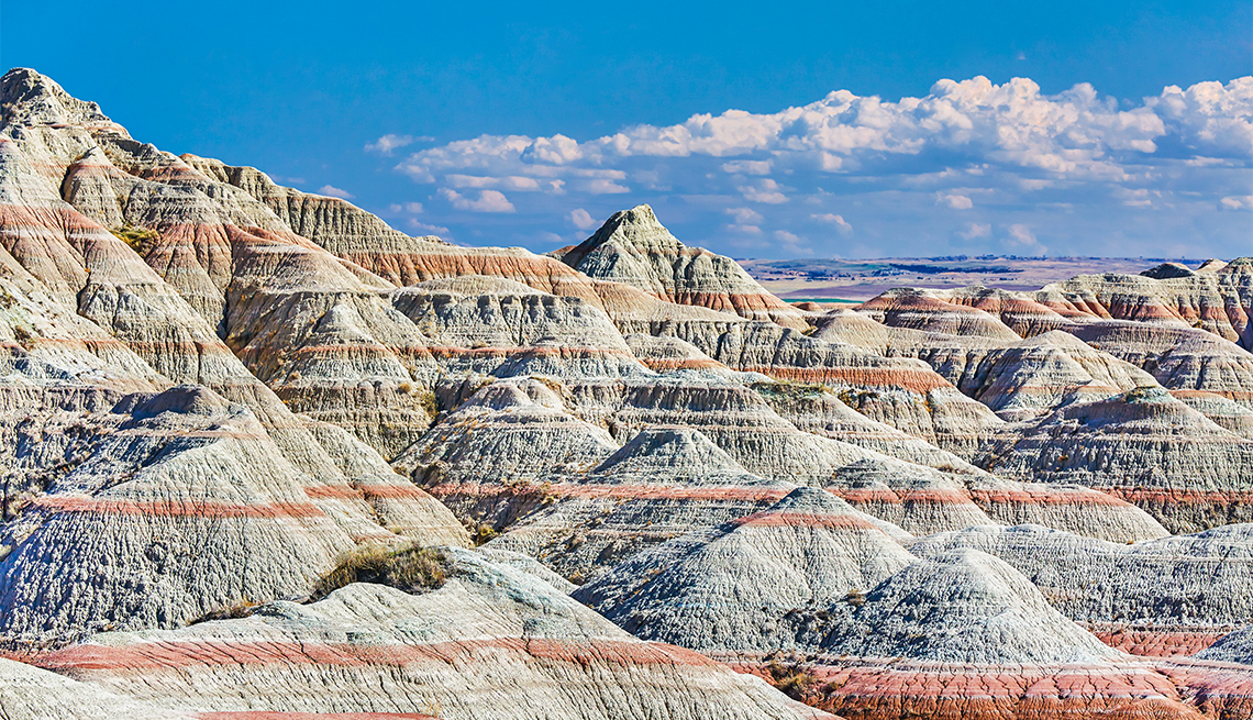 item 4 of Gallery image - View of layered colored hills in the Badlands National Park, South Dakota