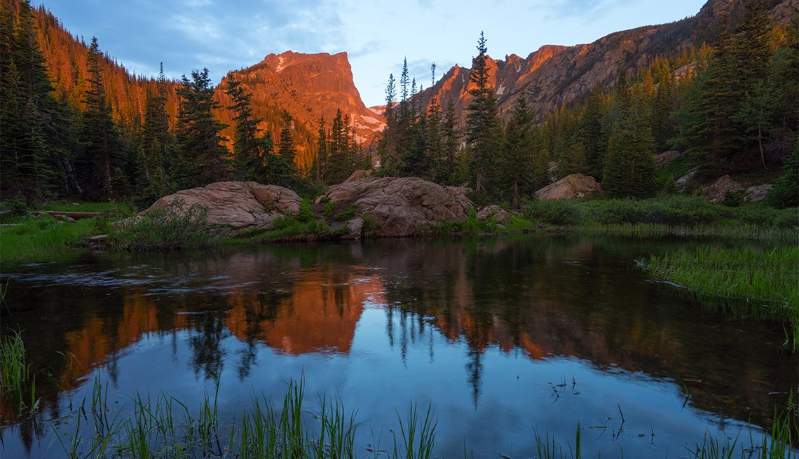 item 1, Gallery image. Hallett Peak reflects in Dream Lake, a popular destination for hikers.